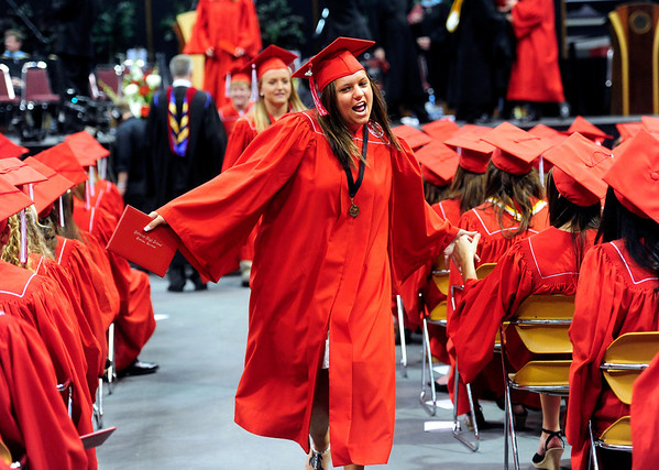 "FVGRAD<br /> Ashley Parada high-fives her classmates after receiving her diploma at Fairview High School's graduation at the Coors Event Center on Sunday. For a video about the graduation, see  <a href=""http://www.dailycamera.com"">http://www.dailycamera.com</a>.<br /> <br /> Photo by Marty Caivano/May 22, 2011"