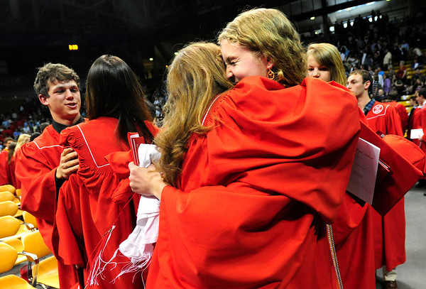 FVGRAD<br /> Kate Travis, right, is hugged by Madi Kois after the Fairview High School graduation at the Coors Event Center on Sunday.<br /> <br /> Photo by Marty Caivano/May 22, 2011