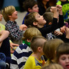 "KRISTOPHER RADDER - BRATTLEBORO REFORMER<br /> Hayden Bartel, a second-grader at NewBrook Elementary, lifts his fist in joy as the Leland & Gray band plays the ""Imperial Death March"" from Star Wars during an assembly on Tuesday, Feb. 13, 2018."