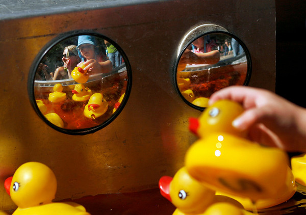 "Lia Sims chooses a rubber ducky worth one small prize on Saturday, Sept. 25, during the Fall Festival along Pearl Street.<br /> For photo gallery and video, go to  <a href=""http://www.dailycamera.com"">http://www.dailycamera.com</a><br /> Daniel Clements / For the Camera"