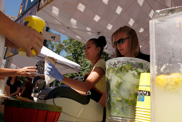 """Angelique Houle and Andrea Milholm, right, serve up """"fast food of the Middle East"""" from Falafel King on Saturday, Sept. 25, during the Fall Festival on Pearl Street.<br /> For photo gallery and video, go to  <a href=""""http://www.dailycamera.com"""">http://www.dailycamera.com</a><br /> Daniel Clements / For the Camera"""
