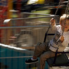"Marcus takes a ride on a swing Saturday, Sept. 25, during the Fall Festival along Pearl Street.<br /> For photo gallery and video, go to  <a href=""http://www.dailycamera.com"">http://www.dailycamera.com</a><br /> Daniel Clements / For the Camera"