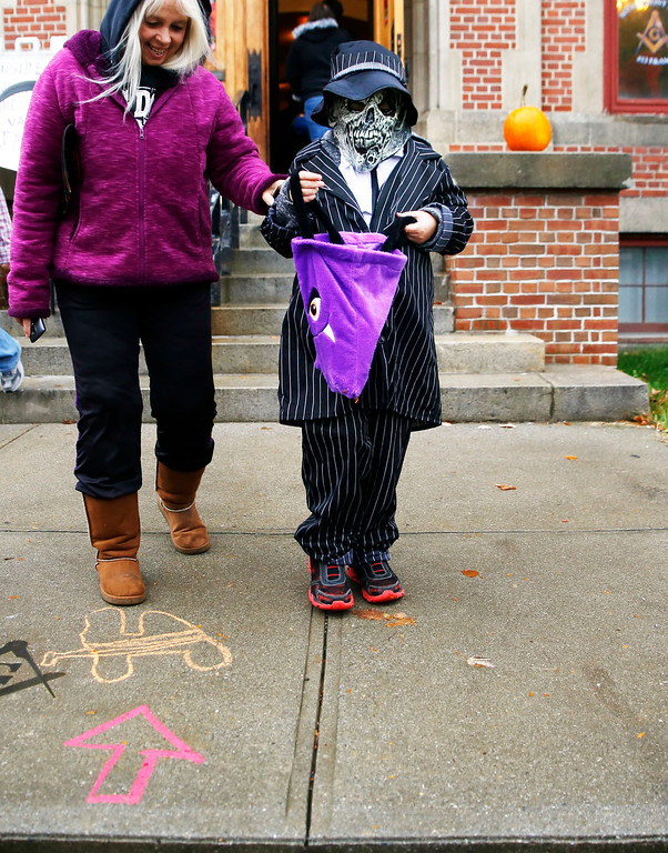. Holly Pelczynski - Bennington BannerRiley Burdick, of Bennington checks his bag for candy while trick or treating, during the Fallpalooza event held on Saturday on Main St. in Bennington.