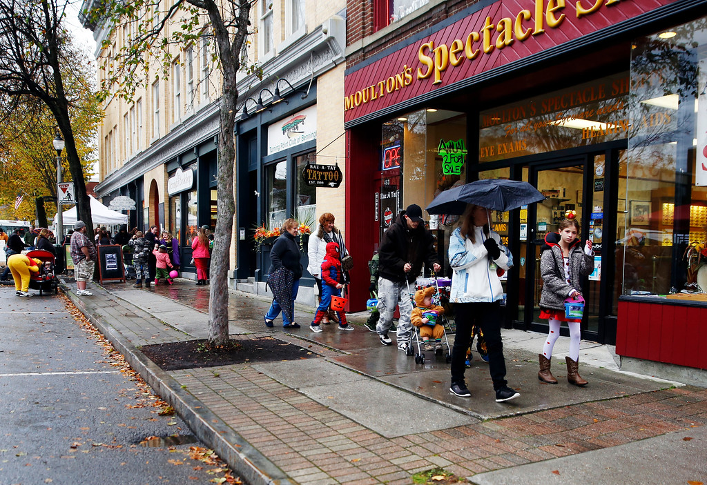 . Holly Pelczynski - Bennington Banner Trick Or Treaters were ready for candy and for some rain. Carrying umbrella\'s in one hand and candy bags in the other they filled Main St. for the Fallapalooza event on Saturday in Bennington.