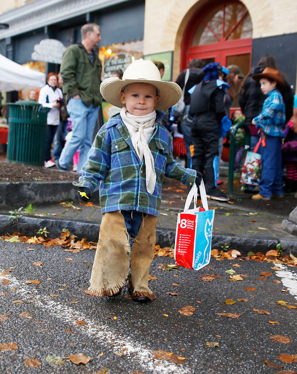 . Holly Pelczynski - Bennington Banner Levi Olsen, of Hoosick Falls makes his way through Main st while looking for some candy during the Fallpalooza event held on Saturday on Main St. in Bennington.