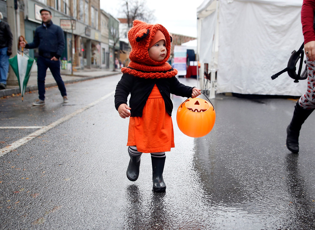 . Holly Pelczynski - Bennington Banner Colette McKenna, 2 years old of Poughkeepsie NY stomps in the rain while trick or treating with some relitives of Bennington, during the Fallpalooza event held on Saturday on Main St. in Bennington.