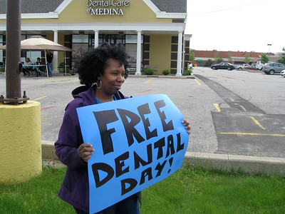 BOB SANDRICK / GAZETTE Lisha Hino, an office administrator at Twinsburg Dental Associates, volunteered for Free Dentistry Day on Saturday at Family Dental Care of Medina.