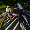 KRISTOPHER RADDER — BRATTLEBORO REFORMER<br /> Families First, located at the Austine Campus, in Brattleboro, hosts a fundraising car wash on Tuesday, Aug. 27, 2019. Chuck Deome, who organized the event, said that he hopes to raise money to be able to go to his first New England Patriots football game and bring along some of his friends. By 10:30 a.m. they washed around 20 to 30 vehicles. The car wash will last to around 3 p.m. with a cost of $7 per vehicle.