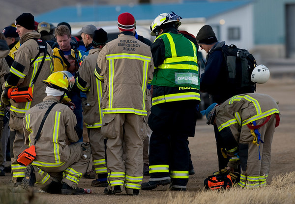 Rescue crews assemble to search for remains around the debris of an airplane and glider crash near where U.S. 36 meets with Broadway just outside of Boulder, Saturday, Feb. 6, 2010. <br /> KASIA BROUSSALIAN