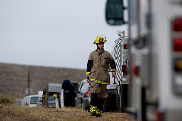 Rescue crews assemble around the debris of an airplane and glider crash near where U.S. 36 meets with Broadway just outside of Boulder, Saturday, Feb. 6, 2010. <br /> KASIA BROUSSALIAN