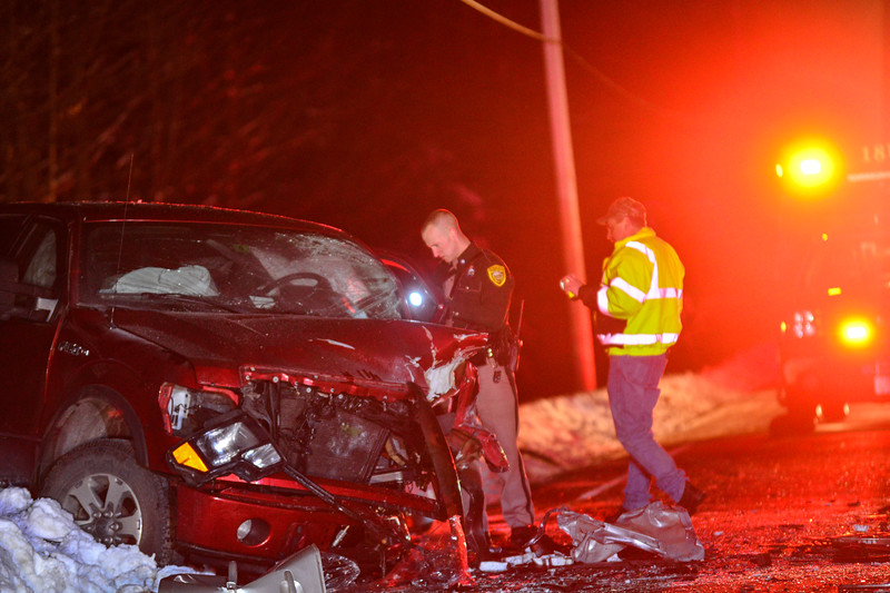 """KRISTOPHER RADDER - BRATTLEBORO REFORMER<br /> State and local police investigate a head-on motor vehicle collision on New Hampshire Route 63, in Hinsdale, that left a young male dead on Friday, March 9, 2018.  Five people were traveling in the two vehicles. Two people were transported for serious injuries to Brattleboro Memorial Hospital, in Brattleboro, Vt., and a third person took themselves to a hospital with unknown injuries. One person was ejected from one of the vehicles. Brattleboro Fire Department was called to the scene to use the """"Jaws-of-Life"""" to get one of the passengers. Route 63 will be closed down during the investigation."""