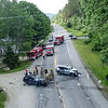 KRISTOPHER RADDER - BRATTLEBORO REFORMER<br /> Firefighters pick up their tools as members of the Vermont State Police start to recreate the crash scene of a fatal incident on Route 30, near Grimes Hill Road, in Newfane, on Friday, June 8, 2018.