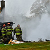 Crews respond to a second-alarm fire at 271 Autumn Hill Drive, in Guilford, on Tuesday, Oct. 9, 2018. Initial reports indicate that one person died in the fire.
