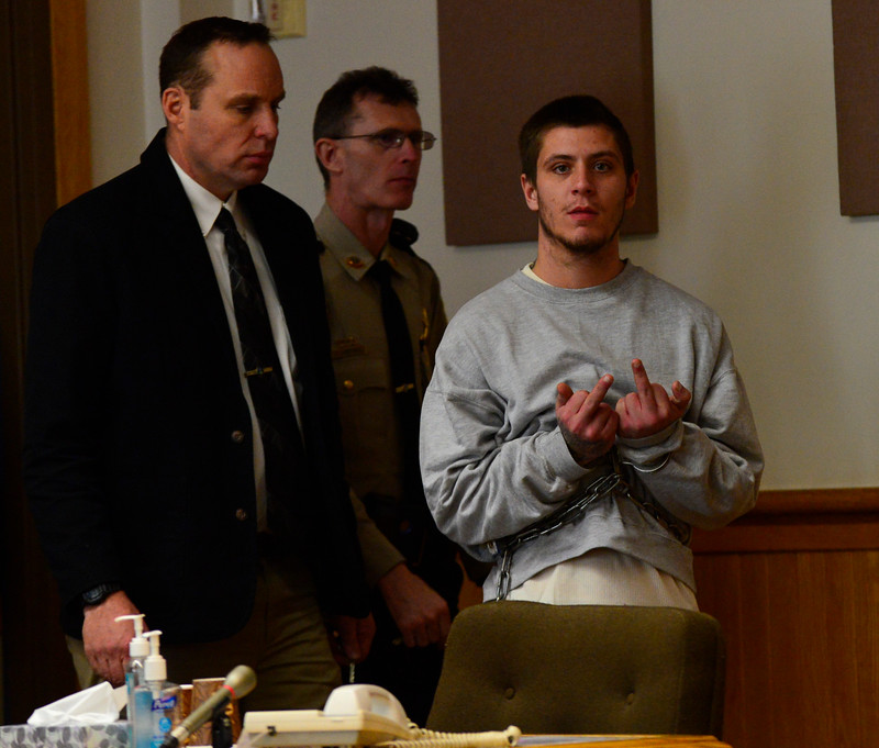 KRISTOPHER RADDER - BRATTLEBORO REFORMER<br /> Jonathan Lenois, 25,  flips off the camera while entering the Windham Superior Court Criminal Division on Monday afternoon.
