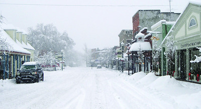 Times Sentinel photo Zionsville's Main Street was virtually deserted Sunday as about a foot of snow fell.