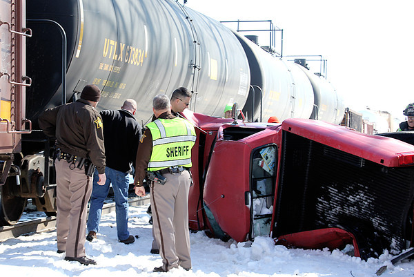 Reporter photo by Rod Rose<br /> Boone County Sheriff deputies and Jamestown firefighters inspect the wreckage of a pickup that authorities said drove into the path of a CSX  freight train about 11:30 a.m. Wednesday just outside Jamestown.