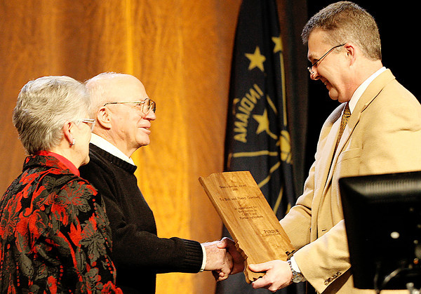 Purdue News Service photo<br /> Jay Akridge, Glenn W. Sample Dean of Purdue Agriculture, presents the Dean's Service Award to Bob and Nancy Guernsey, Lebanon, at the Purdue University Agricultural Alumni Association's annual Fish Fry in Indianapolis Feb. 1.