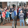 "Reporter photo by Rod Rose<br /> Staff and visitors at the Thorntown Public Library wave and shout in the annual ""hoodie-hoo"" ritual intended to frighten away winter, Thursday."