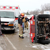 Reporter photo by Rod Rose<br /> Andrew Hale, Indianapolis, a passenger in this Jeep Wrangler, was thrown from the vehicle into a snow bank after the driver, identified by police as Brandon Gillam, Indianapolis, in black jacket at far left, lost control on snow-covered north bound U.S. 52 just past a bridge over Interstate 65 about 11:30 a.m. Monday. Gillam was not injured. The extent of Hale's injuries was unknown at press time.