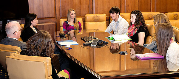 Photo submitted<br /> Western Boone Voice students Gracie Dickerson (third from left); Cory Purkhiser, Ashley Smith, Kiara Caldwell and Bree Wilson sit across from State Sen. Mike Delph (far left) as they and Tobacco Free Boone County coordiator Angie Dickerson (back to camera) and Lynette Clark, director of integrative wellness and Voice adult ally, during a visit to the Indiana Statehouse Thursday.
