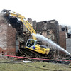 Mike McMahon - The Record, 2139 and 2141 5th Ave building being demolished from Sunday's fire.  Febuary 03, 2014.