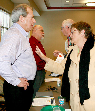 Reporter photo by Rod Rose<br /> Boone County Assessor Lisa Garoffolo asks State Sen. Phil Boots a question, as State Rep. Tim Brown (second from left) chats with others, during a legislative breakfast Saturday at Witham Health Services in Lebanon.