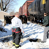 Reporter photo by Rod Rose<br /> Lindy Eberle describes to a Jamestown firefighter the sound of the pickup truck in background being struck by a CSC freight train about 11:30 a.m. Wednesday at the east edge of Jamestown.