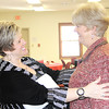 Reporter photo by Rod Rose<br /> Anita Bowen, executive director of Boone County Senior Services, Inc., greets predecessor Sue Ritz at the agency's annual meeting Wednesday.