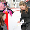 Mike McMahon - The Record, 2002 Olympic gold medalist Sarah Hughes signs a autograph for Lindsay Mattenson of Fuera Bush, will make a special visit to the Capital Region with appearances at the Empire State Plaza ice rink .  Febuary 01, 2014.