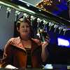 Shanna Henry pours a dark beer for a customer at Flat 12's recently opened Jeffersonville location on Saturday evening. <br /> Staff photo by Tyler Stewart
