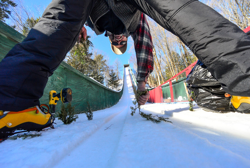 KRISTOPHER RADDER - BRATTLEBORO REFORMER<br /> Ken Barker puts pine onto the inrun to help show jumpers where the edge is at the Harris Hill Ski Jump in Brattleboro, Vt., on Friday, Feb. 17, 2017.