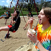 "Jed Storie, right, a University of Wyoming students, swings with his Boulder friends while eating ice cream.<br /> Several people took advantage of the warm Saturday by playing at Scott Carpenter Park.<br /> For more photos and a video at Scott Carpenter Park, go to  <a href=""http://www.dailycamera.com"">http://www.dailycamera.com</a>.<br /> Cliff Grassmick/ May 7, 2011"