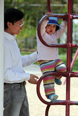 """Esther Wang, 2, has fun with her father, Hongli, while climbing at Scott Carpenter.<br /> Several people took advantage of the warm Saturday by playing at Scott Carpenter Park.<br /> For more photos and a video at Scott Carpenter Park, go to  <a href=""""http://www.dailycamera.com"""">http://www.dailycamera.com</a>.<br /> Cliff Grassmick/ May 7, 2011"""