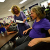 KRISTOPHER RADDER — BRATTLEBORO REFORMER<br /> Cynthia Payne-Meyer, a former teacher at Westminster Elementary School, helps tutor children after school to help them with math. Payne-Meyer became a tutor after an accident in Hawaii left her a paraplegic.