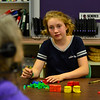 KRISTOPHER RADDER — BRATTLEBORO REFORMER<br /> Katalina White, a sixth-grader at Westminster Elementary School, listens how to use bricks when solving various fraction questions.
