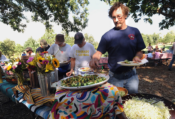 "Roger Hall, of the Sugarloaf Fire District, gets food during the picnic.<br /> Evacuees from the Four Mile Fire,  firefighters, volunteers, and others were given an all family fire relief picnic dinner at Chautauqua on Thursday, provided by Colorado Chautauqua and Boulder's top chefs.<br /> For a video and more photos from the picnic,  go to  <a href=""http://www.dailycamera.com"">http://www.dailycamera.com</a>.<br /> Cliff Grassmick / September 16, 2010"
