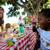 "Heather Vermeer, left, eats with  her son, Kiri, 3, who also endured the Haiti earthquake.<br /> Evacuees from the Four Mile Fire,  firefighters, volunteers, and others were given an all family fire relief picnic dinner at Chautauqua on Thursday, provided by Colorado Chautauqua and Boulder's top chefs.<br /> For a video and more photos from the picnic,  go to  <a href=""http://www.dailycamera.com"">http://www.dailycamera.com</a>.<br /> Cliff Grassmick / September 16, 2010"