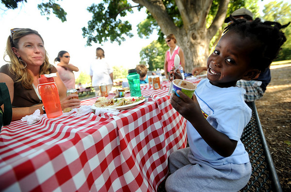 """Heather Vermeer, left, eats with  her son, Kiri, 3, who also endured the Haiti earthquake.<br /> Evacuees from the Four Mile Fire,  firefighters, volunteers, and others were given an all family fire relief picnic dinner at Chautauqua on Thursday, provided by Colorado Chautauqua and Boulder's top chefs.<br /> For a video and more photos from the picnic,  go to  <a href=""""http://www.dailycamera.com"""">http://www.dailycamera.com</a>.<br /> Cliff Grassmick / September 16, 2010"""