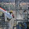 KRISTOPHER RADDER — BRATTLEBORO REFORMER<br /> A crew from Green Mountain Power works on unhooking a piece of equipment that caught on fire at the power substation on Putney Road on Friday, Nov. 1, 2019.