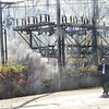 KRISTOPHER RADDER — BRATTLEBORO REFORMER<br /> Brattleboro Fire Chief Mike Bucossi watches as the power substation on Putney Road billows smoke from a fire on Friday, Nov. 1, 2019.