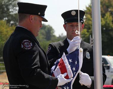 Members of the Chico Fire Department color guard raise the U.S. flag Thursday, Sept. 11, 2014 at the opening of the Sept. 11 memorial at Chico Fire Station 5 in Chico, California. (Dan Reidel - Enterprise-Record)