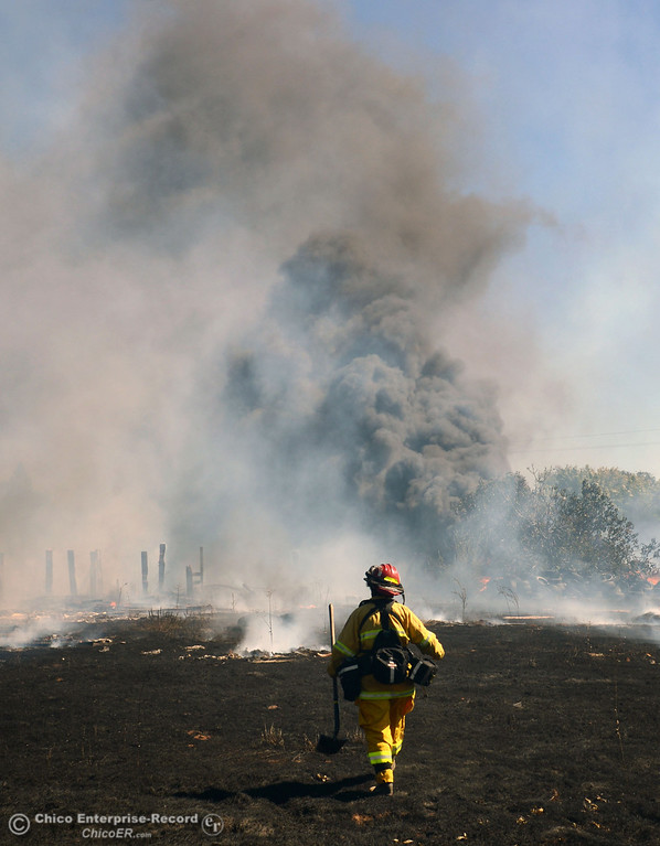 . Cal Fire - Butte County Capt. Lydia Soileau with Oroville Fire and El Medio Fire and battle a fire along Power House Hill Rd and Dad Lane that burned several structures and debris piles Thursday, September 26, 2013, in Oroville, Calif.  (Jason Halley/Chico Enterprise-Record)