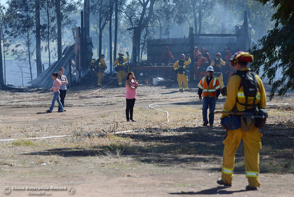 . Oroville Fire, El Medio Fire, and Cal Fire - Butte County battle a fire along Power House Hill Rd and Dad Lane that burned several structures and debris piles Thursday, September 26, 2013, in Oroville, Calif.  (Jason Halley/Chico Enterprise-Record)