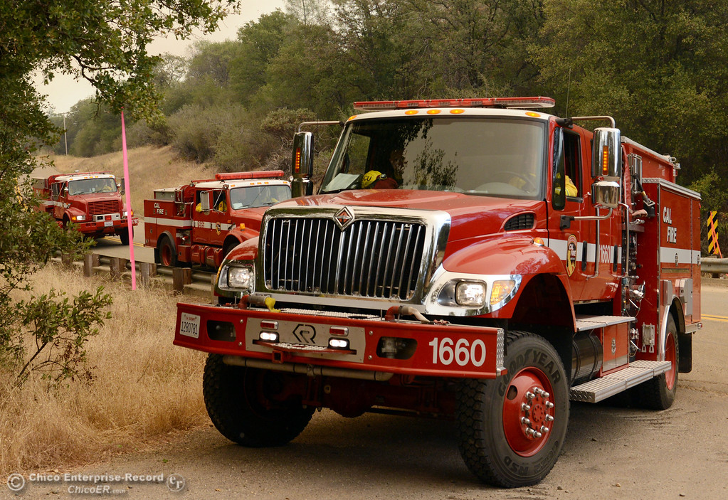 . Cal Fire engines stage at Jerrigan Way and Hurleton Swedes Flat Road as mandatory evacuation areas around the Swedes Fire southeast of Oroville were expanded just after noon Saturday, August 17, 2013 in Oroville, Calif.  (Jason Halley/Chico Enterprise-Record)
