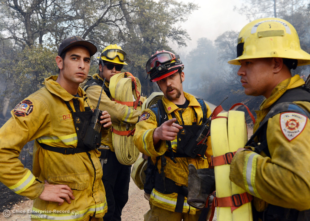. El Medio firefighters Cory Diaz, Brenden Perez, Capt. Donald Robinson, and Alex Otani (left to right) discuss their objective to battle the Swedes Fire that burned along Swedes Flat Road, in the vicinity of Chinese Wall Road, just east or Oro Bangor Highway Friday, August 16, 2013 in Oroville, Calif. Over 200 acres were burned with at least one structure lost. (Jason Halley/Chico Enterprise-Record)