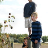 """Will Paulson, 7, left, Bo Lafferty, 8, and Braxton Elsen, 10, watch as firefighters work to rescue a cow from a well on Friday, Oct. 7, at 12166 Jay Rd. in Erie. For more photos and video of the rescue go to  <a href=""""http://www.dailycamera.com"""">http://www.dailycamera.com</a><br /> Jeremy Papasso/ Camera"""