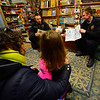 KRISTOPHER RADDER - BRATTLEBORO REFORMER<br /> Matilda Bakersmith, 3, listens while members of the Brattleboro Fire Department read at Everyone's Books, on Elliot Street, as part of the Twinkle Town events on Sunday, Jan. 14, 2018.