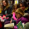KRISTOPHER RADDER - BRATTLEBORO REFORMER<br /> Ulya Smith, 6, reads her book.