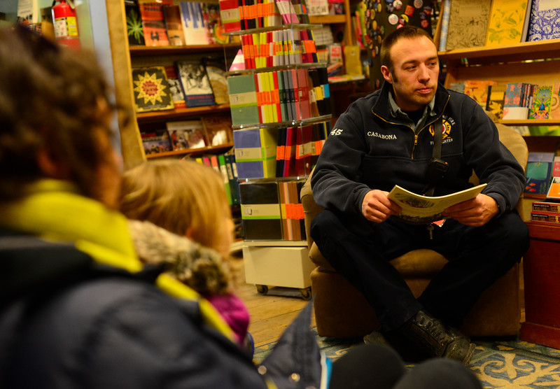 KRISTOPHER RADDER - BRATTLEBORO REFORMER<br /> Brattleboro Firefighters George Allen and Matt Casabona read stories to children at Everyone's Books, on Elliot Street, as part of the Twinkle Town events on Sunday, Jan. 14, 2018.
