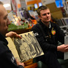 KRISTOPHER RADDER - BRATTLEBORO REFORMER<br /> Brattleboro Firefighter Matt Casabona reads a story about Martin Luther King Jr. during an event at Everyone's Books, on Elliot Street, as part of the Twinkle Town events on Sunday, Jan. 14, 2018.